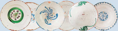 150. Plates decorated with unusual motifs in blues and greens. Others are completely white and some have names painted on them.© Jose L�pez