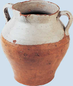 160. Butter jar with carved decorations and a spout.© Jose L�pez