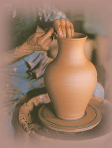 56. A potter shaping a pitcher with a gentle touch.© Jose L�pez